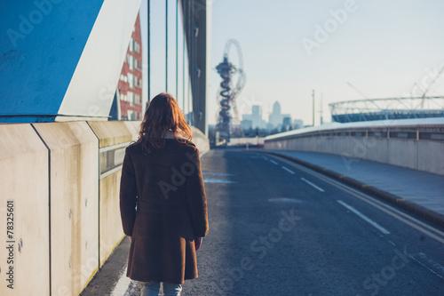 Fototapeta Woman walking in a city in the winter