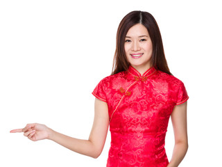 Chinese woman with finger point aside