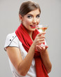 Young girl drink alcohol with glass. Smiling model.