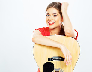 smiling woman portrait with acoustic guitar . white background