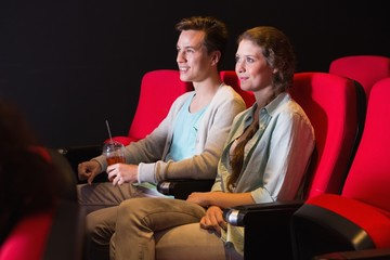 Young couple watching a film