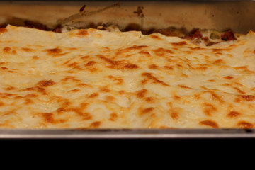 Close up of a lasagna in a metal container