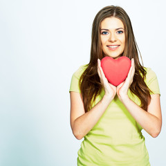 smiling young woman holding  heart .