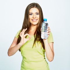 OK symbol. young woman show bottle of water .