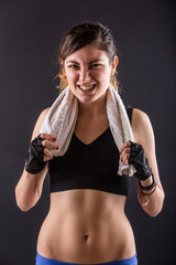 Sporty Young Woman Grinding Teeth on Black Background.