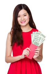 Asian woman hold red pocket with USD