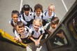 Cute schoolchildren getting on school bus - 78328089