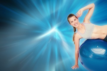 Fit woman stretching on fitness ball