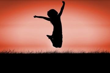 Silhouette of little girl jumping