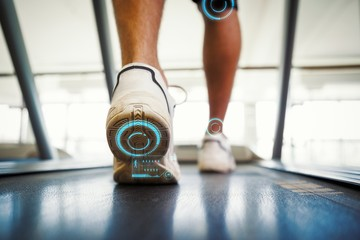 Composite image of man walking on the treadmill