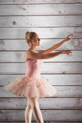 Composite image of pretty ballerina in pink
