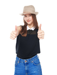 Happy young teenager girl showing thumbs up isolated