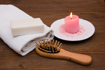 Accessories for body care on wooden table