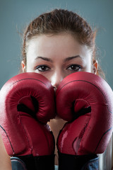 Boxing Woman Behind Two Worn Out Gloves