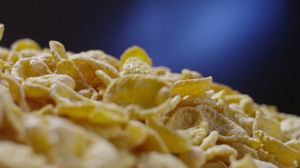 Corn flakes cereals falling tabletop