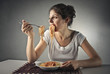 Girl overeating pasta