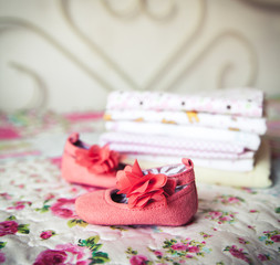 A beautiful gift for a newborn, diapers, pacifiers, peach shoes