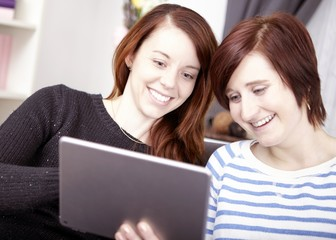 two young girls with tablet computer