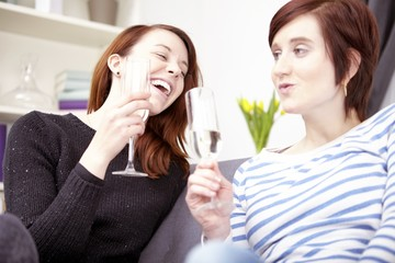 two young girls with champagne