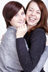 Two girls friends having fun and hug