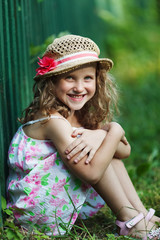 Happy little girl in a straw hat