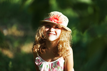 Happy little girl in a hat