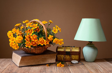 Flowers, books, jewelry box and table lamp