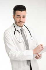 isolated handsome young student doctor with a stethoscope