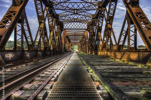 Fotobehang Brug Looking Forward Over Old Abandoned Rusty Train Bridge