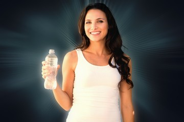 Composite image of brunette with water bottle