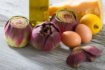 Artichokes, Eggs, Olive Oil, Lemon and Parmesan on Wooden Table