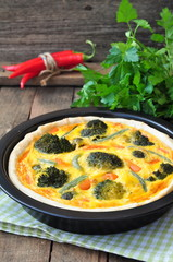 Vegetable pie tart with broccoli, peas, carrot and cheese.