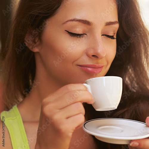 Beautiful enjoying woman drinking coffee from cup outdoors - 78334279