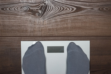 electronic scales on the wooden floor