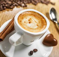 Cup of coffee with candy heart, love symbol