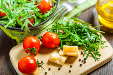 Vegetable salad with Parmesan on table