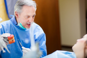 Dentist explaining a treatment to a patient