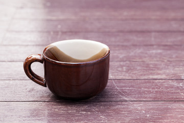 A cup on wood table.