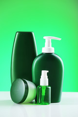 Cosmetic bottles on bright background