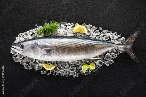 Tuna fish on ice on a black stone table top view - 78336638