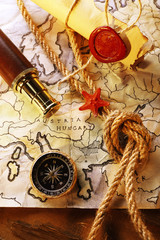 Marine still life with world map and rope