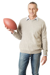 Mature man holding a rugby ball