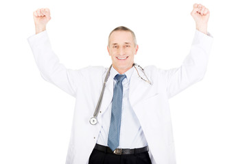 Happy cheerful male doctor with raised arms