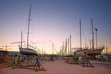 Dry docked sail boats in Kallithea marina, Athens, Greece.