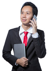 business man talking with mobile phone and hold tablet on hand
