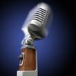 Vintage microphone on blue background