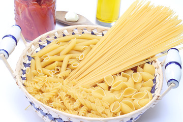 Raw pasta in basket