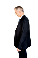 Side view serious businessman looking down