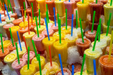 Fototapeta Fruit smoothies at the Boqueria market in Barcelona