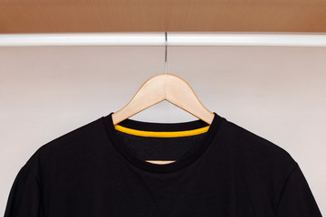 wooden hanger with shirt